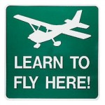 Sign: Learn to fly here!